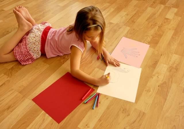 IAQ-050917-girl-laying-on-floor