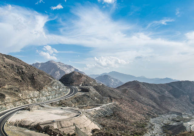 al hada mountains in ta'if city in mecca province of saudi arabia, Sobha Viju behind wheel of car in Saudi Arabia
