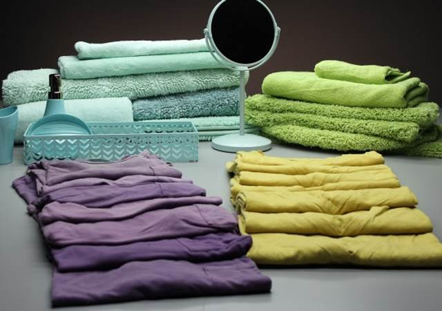 t-shirts, towels, and a mirror reflects the different shades of color