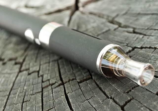 closeup of black e-cigarette on wooden background