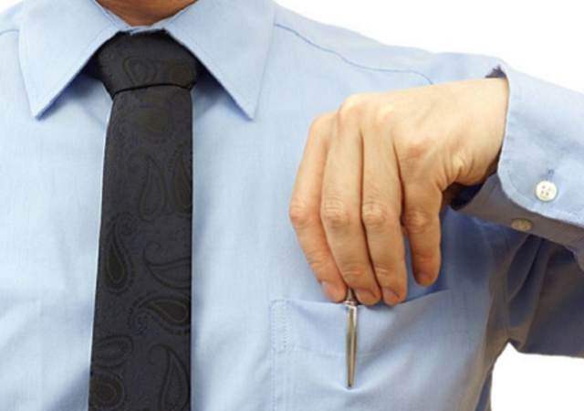 businessman is putting pen back into his pocket