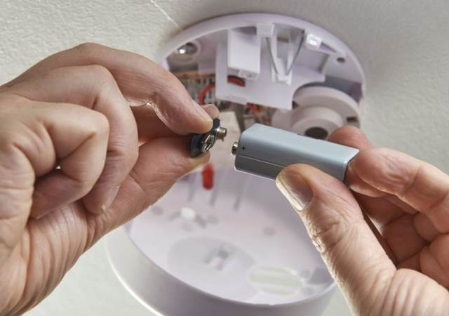 close up of replacing battery in domestic smoke alarm, ,