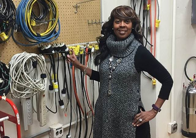 LeVette Martin stands before electrical equipment in UL lab