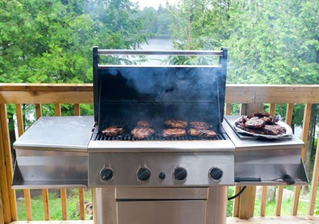 Steaks cooking on a gas grill