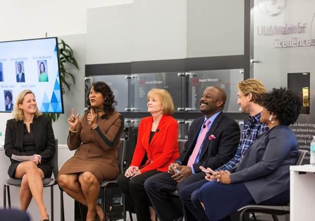 Panel picture of Gitte Schjotz,; Dorri McWhorter; Marla Gottschalk; George Williams; Aaron Lawlor; Wendy Lewis, Wearing a red jacket, Marla Gottschalk speaks before the crowd, UL employee asks question of panel, ,