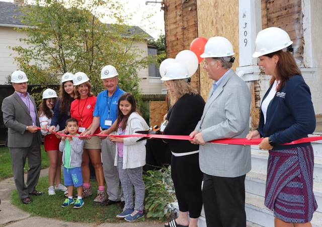 UL sponsors stand with Habitat for Humanity officials at a ribbon cutting ceremony