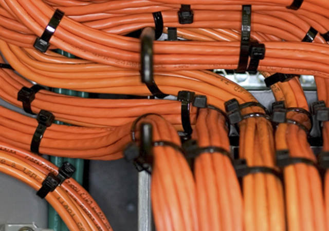 Positioning devices holding cables