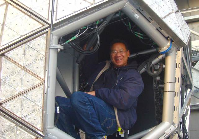 Jimmy Wong having fun by climbing inside the Times Square Ball while its construction was nearing completion