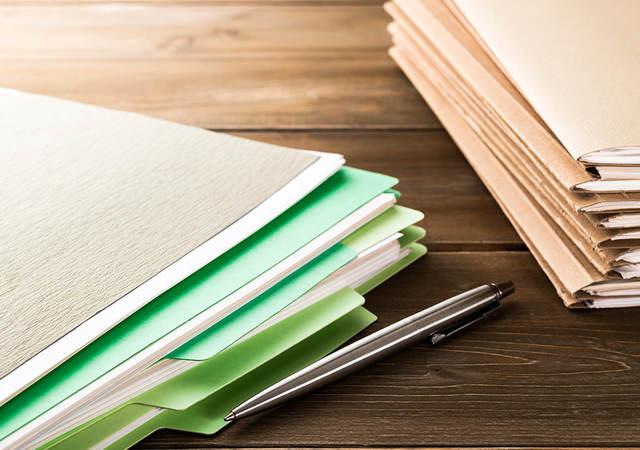Stack of manila document folders