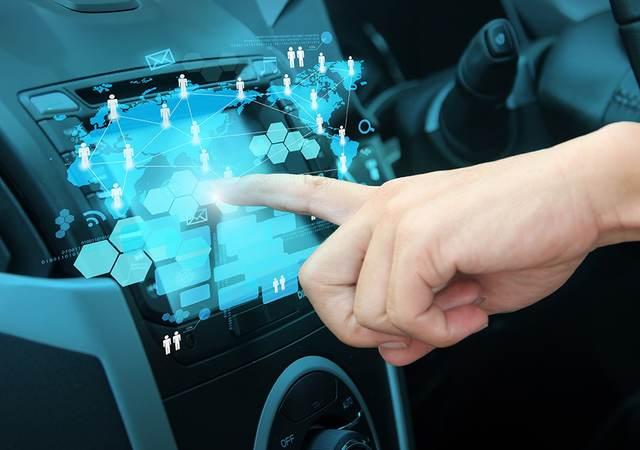 Person touching car UI dashboard