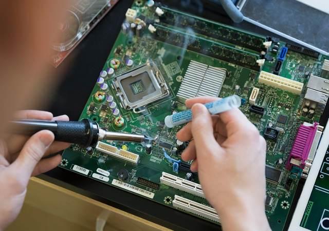 Person soldering a circuit board