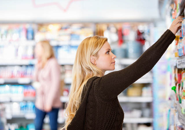 Woman shopping for safer consumer products at a retail store