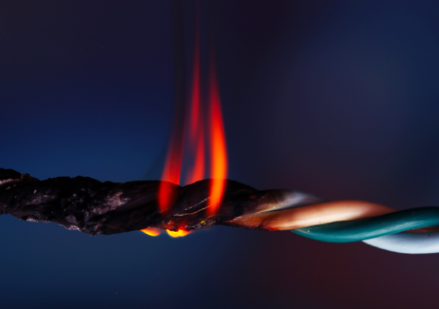 Close up of wire cable that is burning