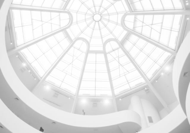 Upward shot of glass ceiling in an atrium