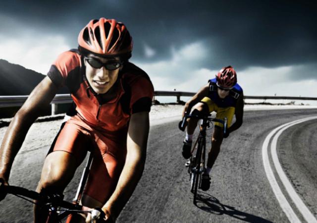 2 men on racing bicycles