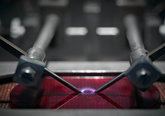 A close-up picture of a machine testing plastic.