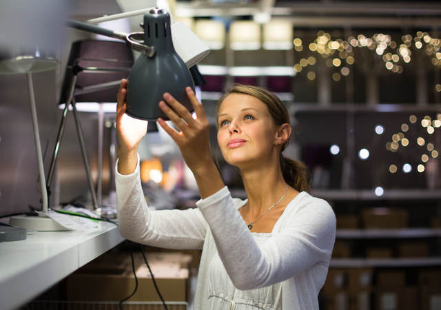 Woman looking up at light equipment