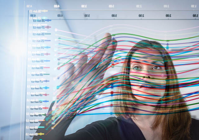 woman looking at a graph