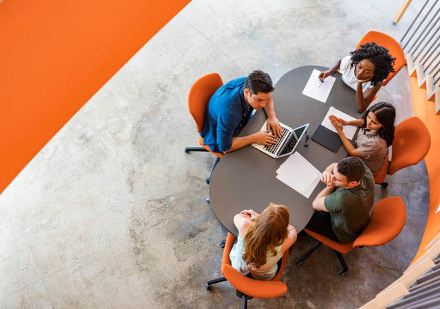 Overhead image of persons at a conference table
