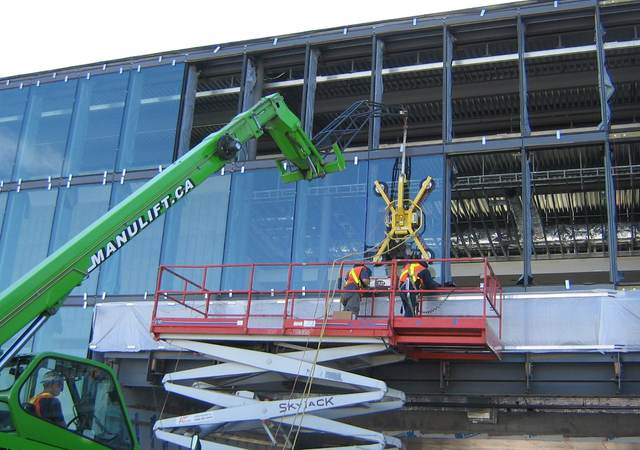 Crane installing windows