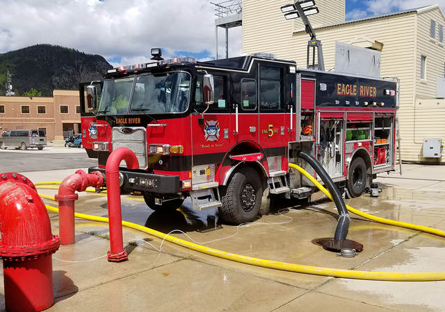 A parked fire truck receiving maintenance.