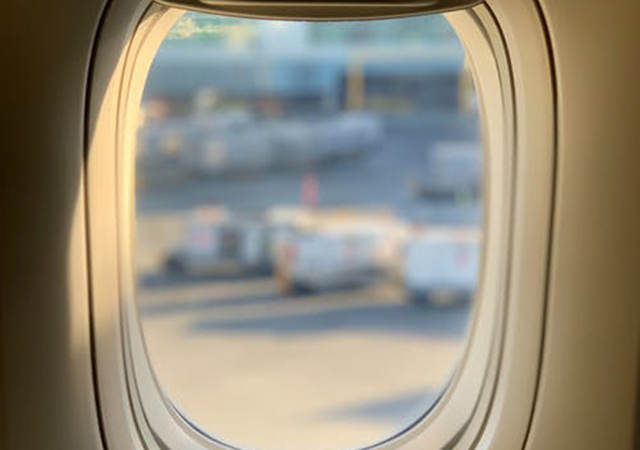 Looking out an airplane window over a tarmac