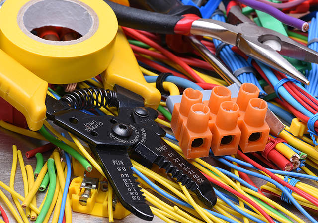 Multiple colored wires with wire cutter and electrical tools