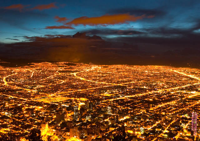 An aerial view of a lighted cityscape