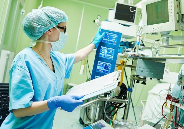 Nurse testing medical device
