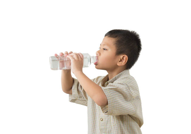A boy drinking from a water bottle.