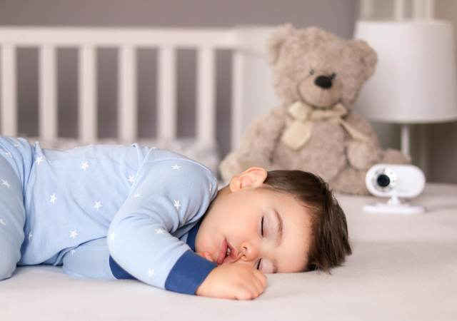 Baby sleeping in a crib.