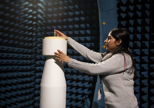 Young girl exploring a large white connected device