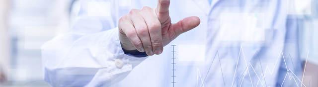 Man touching an interactive computer screen.