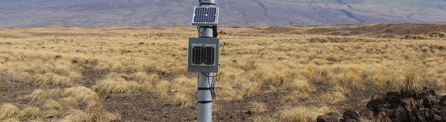 Meteorological tower installed in a field for measuring wind