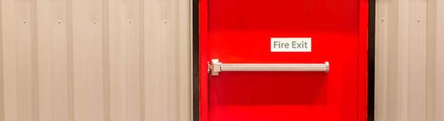 Red door with fire exit sign