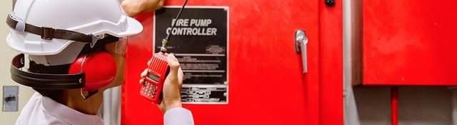 An inspector looks at a fire pump