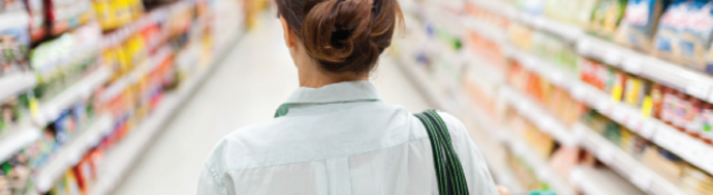 Shot from behind of woman in aisle of a store