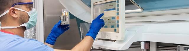 Male nurse checking medical device