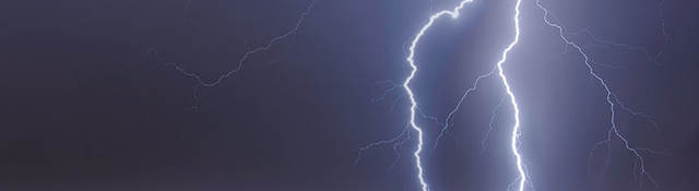Lightning striking cityscape