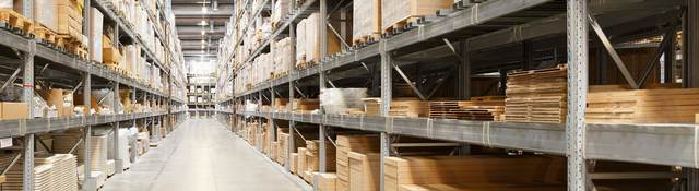 Row of shelves with boxes in warehouse