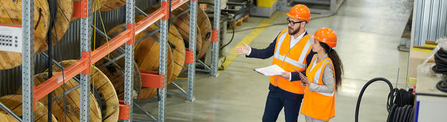 Workers auditing a warehouse