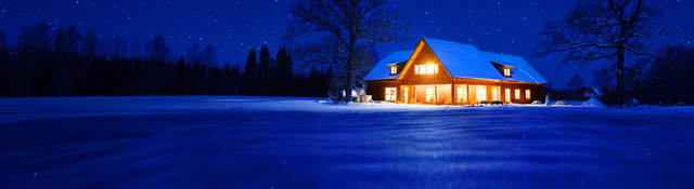Residential home, lit up at night