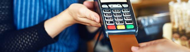 inserted credit card for payment in shop