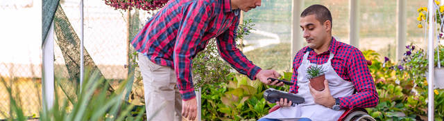 man paying with a mobile phone in flower shop