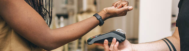 woman using a smartwatch for payment
