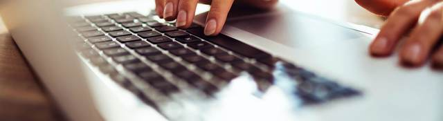 woman typing a laptop computer