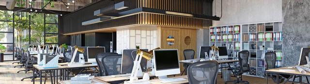 Row of empty desks in a modern office