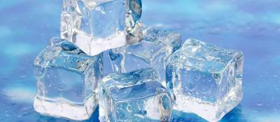Ice on bright blue background