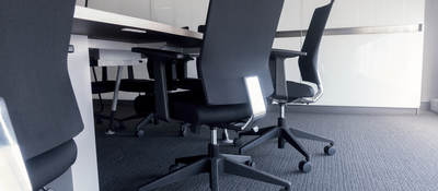 Carpeting in a clean modern conference room.