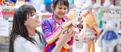 Woman purchasing toys with child